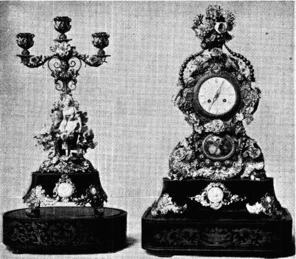 Fig. 13. Pendyl och kandelaber<bfrån 1800-talets midt. Pendylen h. 0,553 m.    Kandelabern h. 0,451 m. N. M. 113,807.