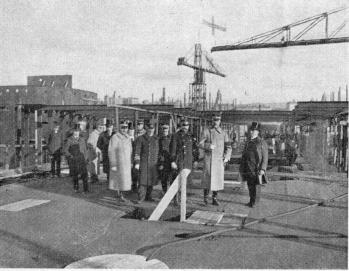 The Cruiser »Sverige» being built at Götaverken, and inspected by His Majesty King Gustav. 2nd Oct 1914