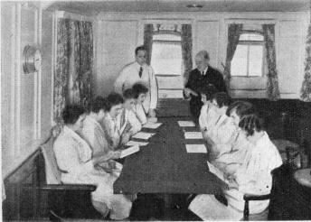 Stewards and stewardesses on Swedish Lloyd's steamers studying English on board their steamers whilst in Port