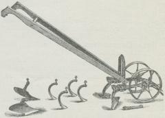 Fig. 2. Dobbelt Hjulhakke med forskellige<bRensejern og Plove.